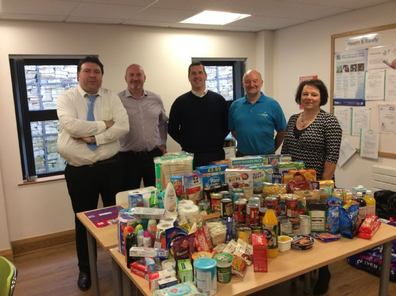 Triangle Staff donate to local Food Bank
