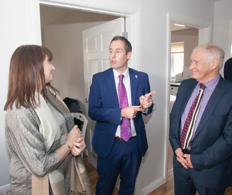 Paul Given (MLA) speaking to Ms Brennan (THA Tenant) and Robert Hutchinson (THA board of management)