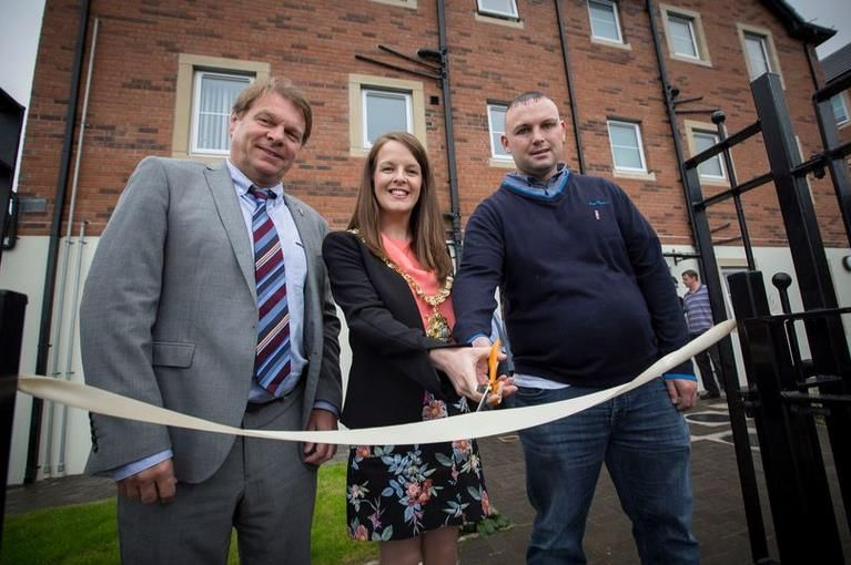 Ballymisert Tenant Michael Thompson cuts the ribbon to officially open the supported living scheme